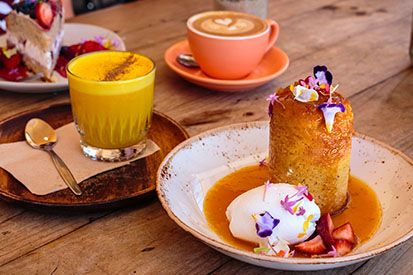 Tumeric Latte, Coffee & Delicious cake from Belle Central