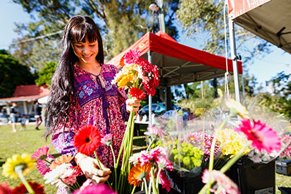 Lady shopping for flowers at Ballina Farmers Market