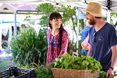 Couple buying vegetables at Ballina Farmers Market