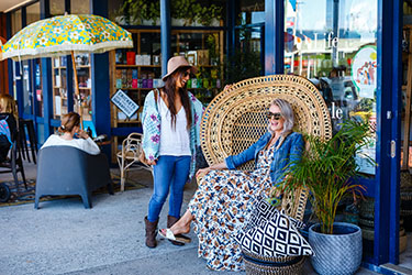 Ladies relaxing out front a shop in Lennox CBD