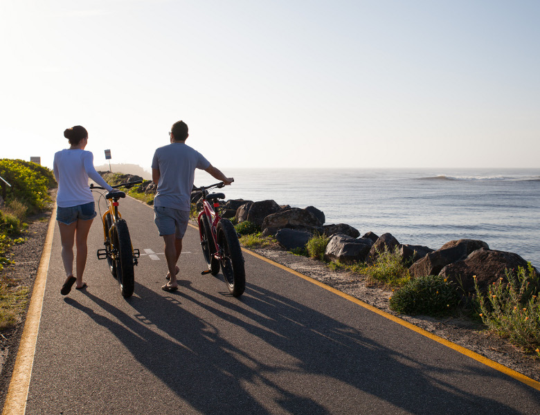 Walking bikes along breakwall