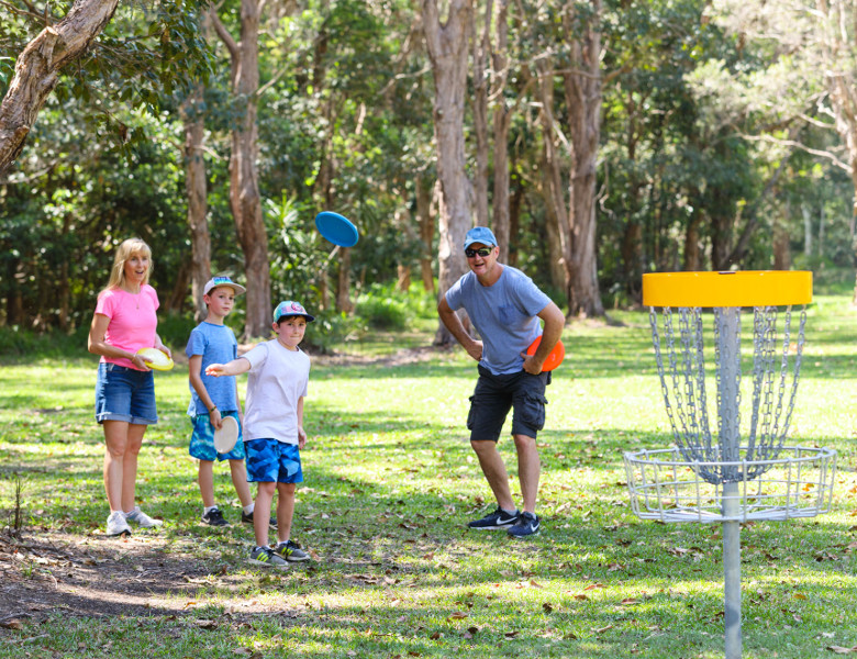 Family playing disc golf
