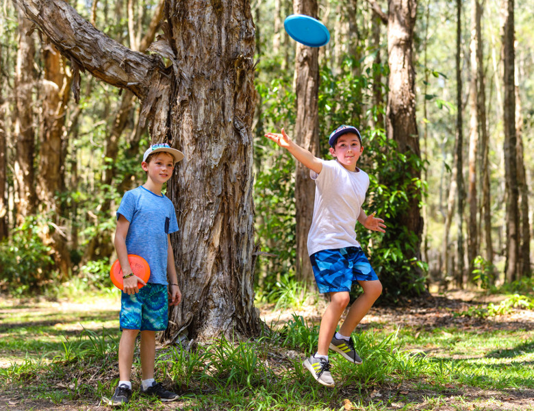 Kids playing Disc Golf in Ballina